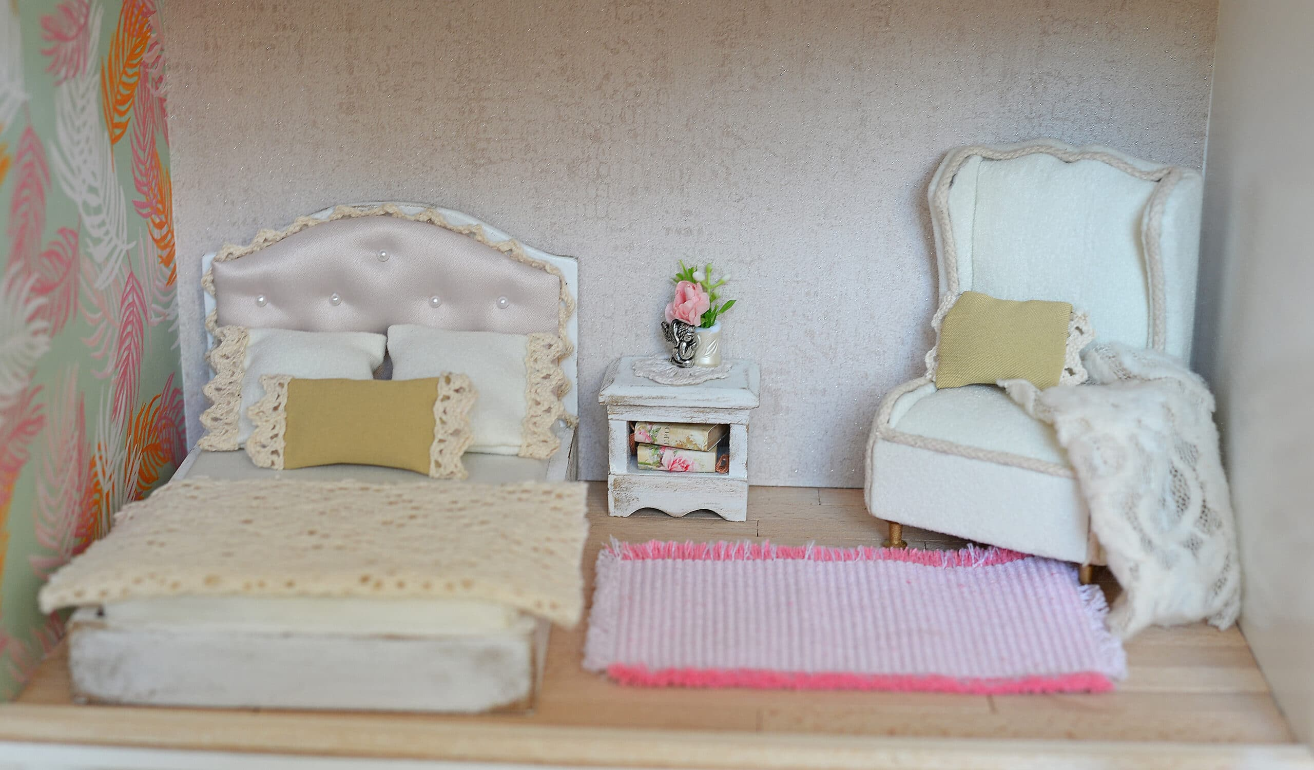 Dollhouse, bedroom with bed and armchair and pink carpet